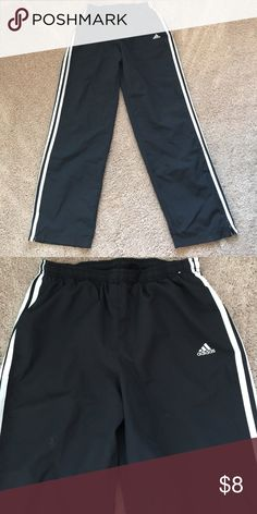 """Adidas wind pants Adidas wind pants.  29"""" inseam, 100% polyester.  Black with white adidas stripes down each leg Adidas Pants Track Pants & Joggers"""