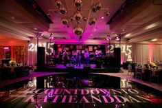 Custom dance floor and Pink and Purple Reception Lighting    Photography: Callaway Gable   Read More:  http://www.insideweddings.com/weddings/festive-new-years-eve-wedding-with-surprises-in-beverly-hills/803/