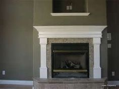 White fireplace surround, with the wall color.