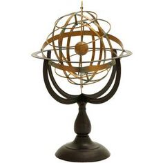 Metal armillary decor in bronze with rotating rings.    Product: Armillary décorConstruction Material: MetalColor: BronzeFeatures:  Rotating rings represent orbiting stars around center sphereIdeal for the living room end table or in the home office Dimensions: 22 H x 14 Diameter