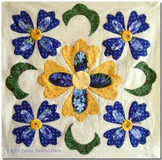 Baltimore Blue Block #1.  No link to a pattern, but love the layout as well as the colors.