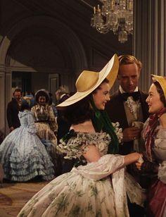 Vivien Leigh as Scarlett O'Hara, Leslie Howard as Ashley Wilkes and Olivia de Havilland as Melanie Hamilton in Gone with the Wind (1939).