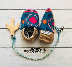baby slippers | Prewalker shoes | baby set -Baby Moccasins+lether pacifier clip+wooden toy cactus | baby shoes | cactus | baby booty | by BabyBOOArt on Etsy https://www.etsy.com/listing/497160392/baby-slippers-prewalker-shoes-baby-set