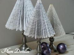 Love the idea of using old hymnals! Christmas trees from old hymnals and fun books.especially pretty on the candlesticks