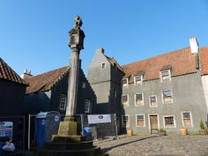 Mercat Cross in Culross, Fife where some of the buildings have been painted grey for the filming of #Outlander, based on the books by Diana Gabaldon