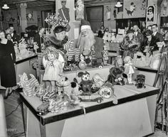 """December 1934. """"Mrs. Roosevelt, on a Christmas shopping tour, inspecting an assortment of toys at a Washington, D.C., department store."""""""