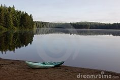 A kayak sitting on the shore of Pog Lake, Algonquin Provincial Park, Ontario, Canada.