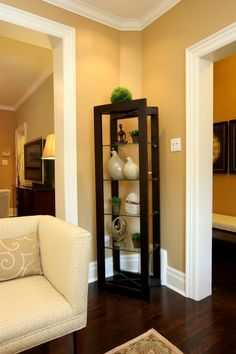 The corner of the room has an awkward angle, making it difficult to place furniture. But a unique curio cabinet fits perfectly.