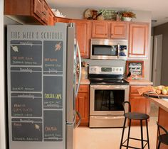 How to create a chalkboard refrigerator schedule using adhesive vinyl and chalkboard markers.