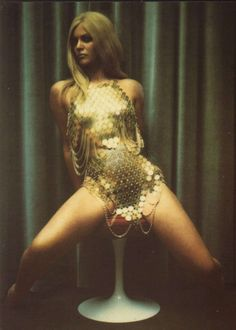 Gold Paco Rabanne dress photographed by Carlo Molino for a 1960s issue of Harper's Bazaar.