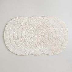 "Double Knot Bath Mat, 20"" x 34"", $16.99 -- beautiful, soft, cushy, reversible, off-white bath rug.  Love the shape, design & texture. Wish it came in a dark gray so I could keep it.."