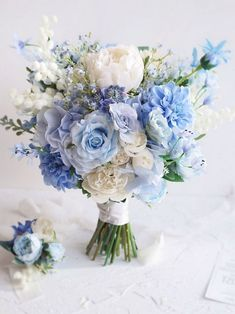 Brides who choose blue wedding bouquets have, not surprisingly, a great affinity for flowers. After all, no matter what shade of blue a bride chooses, this hue Tropical Wedding Bouquets, Artificial Wedding Bouquets, Cascading Wedding Bouquets, Peony Bouquet Wedding, Wedding Flower Arrangements, Flower Bouquets, Bridal Bouquets, Wedding Centerpieces, Blue Bouquet