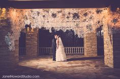 2000 paper snowflakes were hand-cut to create this snowy, shimmery installation backdrop for Erin and Corey's winter wedding.  Installation by Ashley Pepitone, Photo by Janet Howard