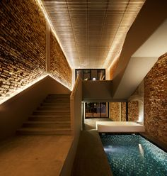 Old Singapore Shophouse Transformed into a Cozy Modern Home With a Pool InsideSingapore-based FARM in collaboration with KD Architects. renovated an old local shop house in Singapore. The 'Pool Shophouse' aims to create a co. Cove Lighting, Stair Lighting, Interior Lighting, Lighting Design, Accent Lighting, Lighting Ideas, Wall Wash Lighting, Indirect Lighting, Linear Lighting