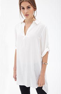 Shop White Lapel Half Sleeve Loose Dipped Hem Blouse online. Sheinside offers White Lapel Half Sleeve Loose Dipped Hem Blouse & more to fit your fashionable needs. Free Shipping Worldwide!