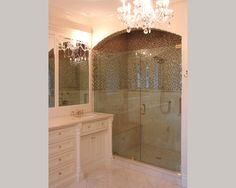 arch shower and chandelier