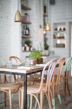 Hally's Parsons Green, communal tables with pastel colored dip dyed bentwood chairs Dining Room Painted Chairs, Painted Furniture, Dipped Furniture, Painted Wood, Furniture Ideas, Decorated Chairs, Painted Bricks, Refinished Furniture, Kitchen Furniture