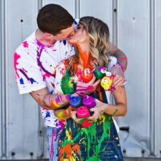 An engaged couple declares a paint war ~ captured by Yvonne Denault Photography.
