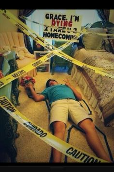 instead of the homecoming thing, I want to do this crime scene with textbooks everywhere and a sign in the background that says I survived college!