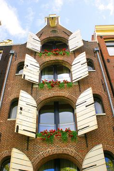 Flower Window - Amsterdam Building  cut arch windows with shutters like these for fairy garden or large easter eggs with bunny looking out