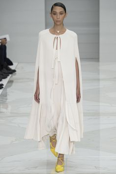 Salvatore Ferragamo - Taking a cue from papal fashion, this cape-and-dress combination with accordion pleats is heavenly.