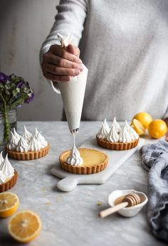 Lemon Meringue Tarts (Paleo, GF) Simple filling and topping idea for a pie crust made with Simple Mills Vanilla Cake Mix!Simple filling and topping idea for a pie crust made with Simple Mills Vanilla Cake Mix! Paleo Dessert, Gluten Free Desserts, Just Desserts, Delicious Desserts, Dessert Recipes, Yummy Food, French Desserts, Meringue Desserts, Coconut Desserts