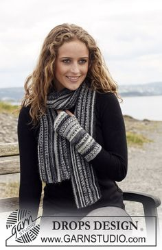 "Set comprising: DROPS wrist warmers in garter st in ""Fabel"" and scarf in ""Fabel"" and ""Alpaca"". ~ DROPS Design"