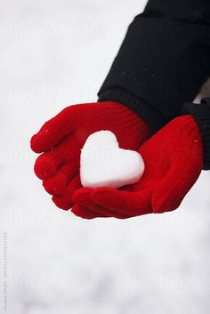 Man holding snow made heart in his hands by jovanarikalo | Stocksy United
