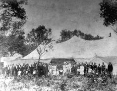 """People gathered outside """"Camp Meeting"""" tent - Miami, Florida: Believed to be Miami's first """"Camp Meeting"""", it was located at 12th Street and 1st Avenue. (1896)"""