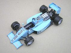 This F1 paper car is a 1987 March 871 (driven by Mauricio Gugelmin), a Formula One racing car designed by the March Racing Team and driven in the 1987 Form