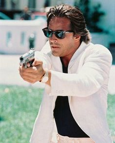 Don Johnson in his legendary white suit and ray ban sunglasses.