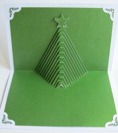 Simple but effective.  Christmas Tree Pop Up Home Décor 3D Handmade Cut by Hand Origamic Architecture in Forest Green and White.