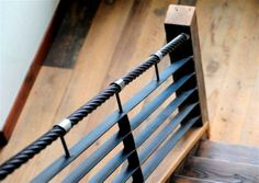 Chair lift cable as hand rail with beetle kill pine wood on staircase