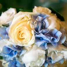 White & cream roses, blue hydrangea and eustoma wedding bouquet in Prague. Delivery of the bridal bouquets in Prague.