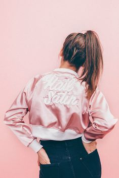 Straight from the school of soft knocks, this Hail Satin jacket boasts the same glossy, lustrous material found in our Mixed Emotions letterman jacket and likely your last prom dress. Hail Satin jacke