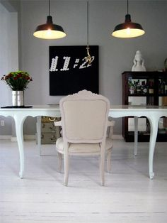 electic dining room with painted white floors and industrial style lighting Dining Table Chairs, A Table, Industrial Style Lighting, White Desks, Dining Room Inspiration, Painted Floors, Living Spaces, Work Spaces, Dining Room Design