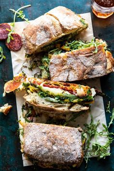 The very best party size Italian Melt. Crusty ciabatta bread, sandwiched with homemade Italian vinaigrette, spicy salami, salty prosciutto, fresh baby arugula, roasted peppers, provolone AND mozzarella. Its the easiest way to serve up a melty sandwich to a hungry group of guests. Perfect for your game day eats!