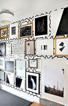 Go big with your gallery wall. Floor to ceiling really makes a statement.