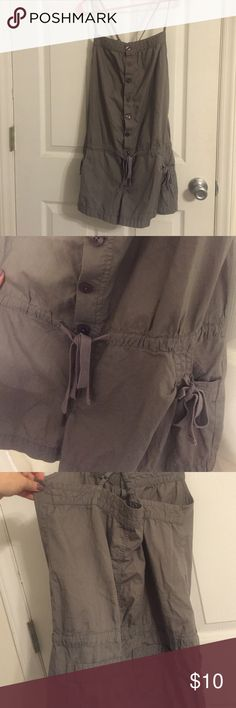 Grey Romper Cross crosses in the back. Tightens at waist. Button Up. Has pockets. Red Camel Dresses