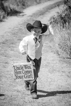 Cowboy Ring Bearer in a West Yellowstone Wedding.  Event planning and Floral Design by Taylor'd Events. TaylordEventsSV.com