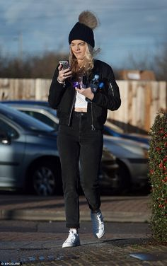 Scrolling the phone: Louisa Johnson was yet again spotted locking lips with her boyfriend Daniel Elliott as they awaited a train at an Essex station on Tuesday