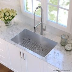Handmade Stainless Steel 16 Gauge 30 x 18 Undermount Kitchen Sink with Faucet Elevate your kitchen style with an expertly-selected kitchen combination from Kraus. The Handmade Stainless Steel 16 Gauge 30