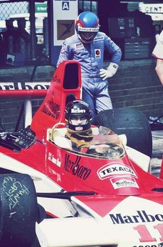James Hunt at South Africa 1976 with a very curious Patrick Depailler