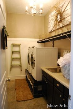 A laundry room with a chandelier - could make doing laundry fun!