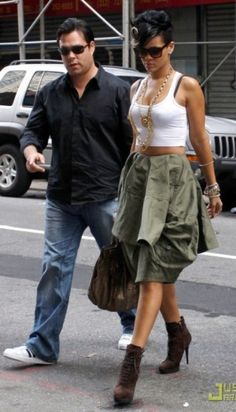 Rihanna wearing Zagliani Python Puffy Satchel, Yves Saint Laurent Suede Booties and Comme Des Garcons Skirt.