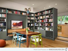 always loved the idea of having books/bookcases in the dining room, especially for cook-books.  Love the built-in wine rack.