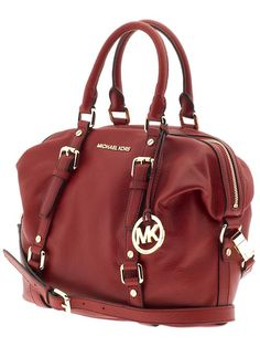 My mother got the brown one of this purse, but i like this color better
