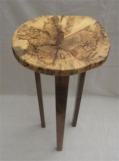 Three Legged Display Table. I hand crafted this very nice art deco rustic looking small 3 legged display table, the table top is a rare wood that tells it's own story with it's wonderful display of art, it is from the center trunk of a spalted hackberry tree, the legs are made from Walnut. More photos can be viewed by clicking on the image.