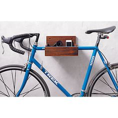 We'll hang two bikes this way and two the other way... wood bike storage in wall mounted storage | CB2