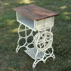 Antique sewing machine base becomes lovely table with shelf.